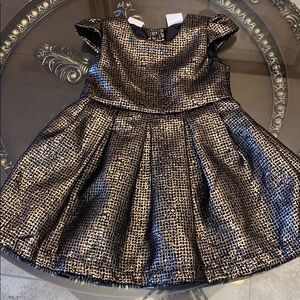 Kardashian kids gold and black dress